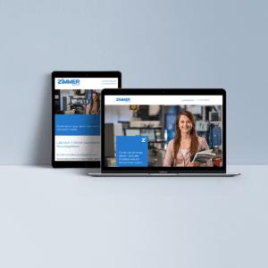 Tablet und Laptop zeigen Zimmer Website an